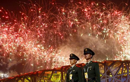 2 chinese militars in front of a firework